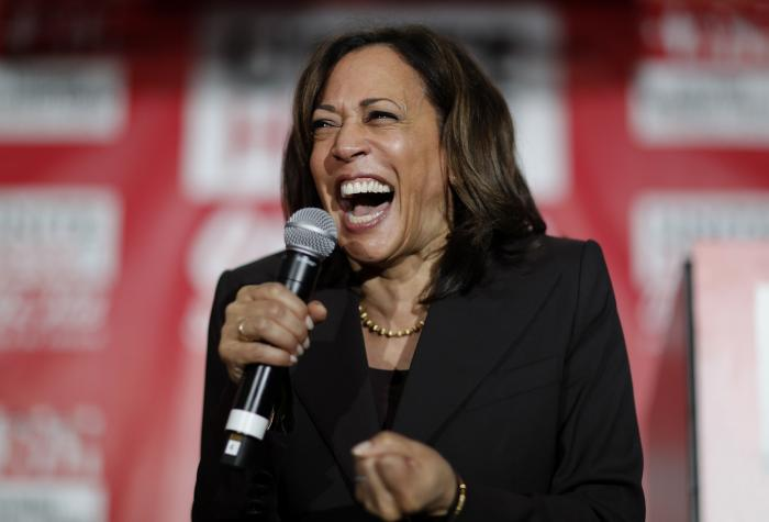 Then-Democratic presidential candidate Sen. Kamala Harris, D-Calif., reacts as she speaks at a town hall event at the Culinary Workers Union in Las Vegas.