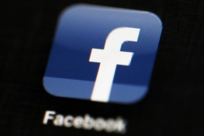 This May 16, 2012 file photo shows the Facebook app logo on a mobile device in Philadelphia. On Monday, Oct. 12, 2020,