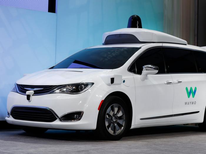 In this Jan. 8, 2017, file photo a Chrysler Pacifica hybrid outfitted with Waymo's suite of sensors and radar is displayed at the North American International Auto Show in Detroit