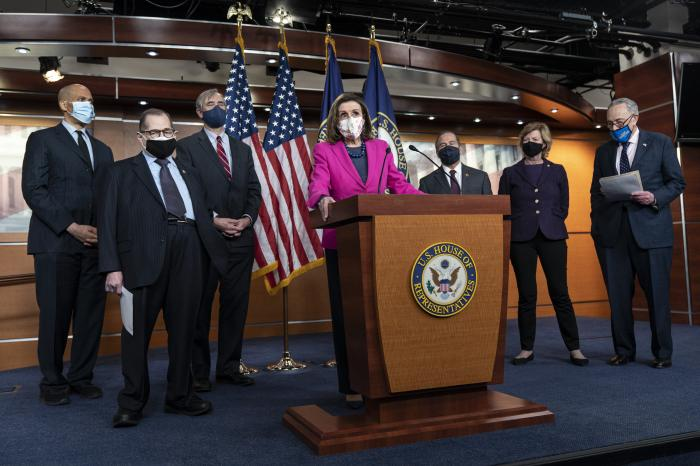 House Speaker Nancy Pelosi of Calif., center, speaks about the Congress Equality Act.