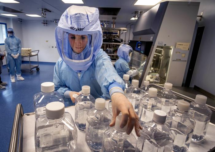 A laboratory worker simulates the workflow in a cleanroom of the BioNTech Corona vaccine production in Marburg, Germany.