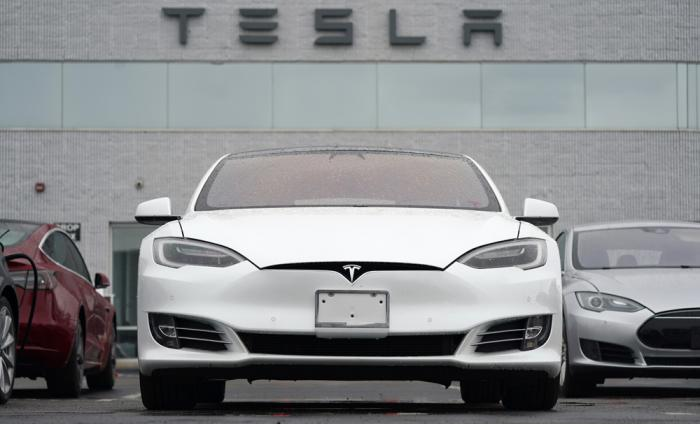 This Sunday, May 9, 2021 file photo shows vehicles at a Tesla location in Littleton, Colo.