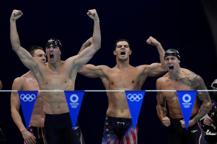The United States' men's 4x100-meter medley relay team, from left, Ryan Murphy, Zach Apple, Michael Andrew and Caeleb Dressel, celebrate winning the gold medal at the 2020 Summer Olympics, Sunday, Aug. 1, 2021, in Tokyo, Japan. (AP Photo/Gregory Bull)