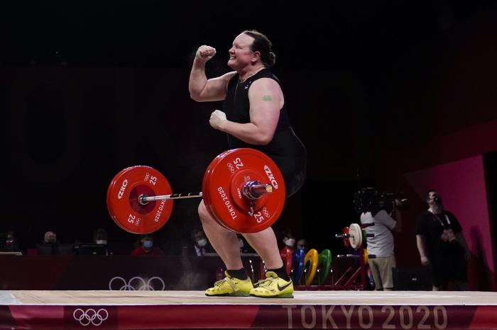 Laurel Hubbard of New Zealand reacts after a lift in the women's +87kg weightlifting event at the 2020 Summer Olympics.