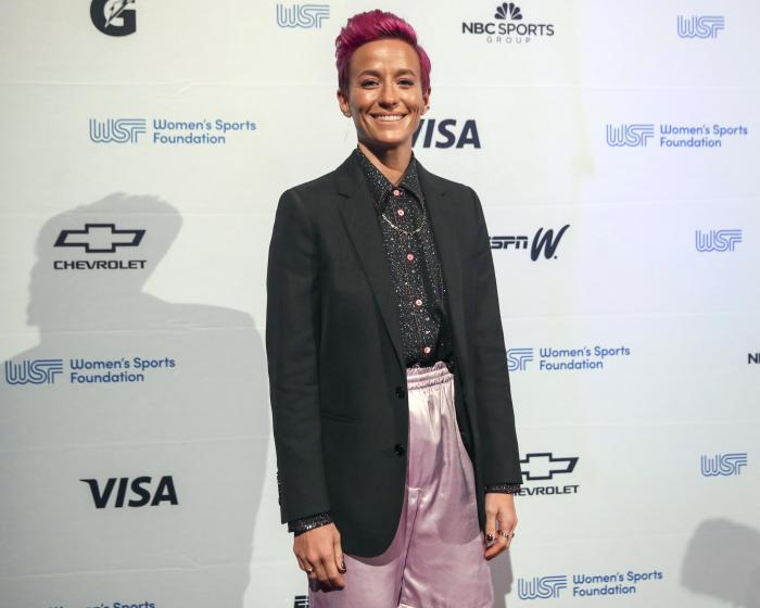 Soccer player Megan Rapinoe poses for photos on the red carpet of the Women's Sports Foundation's 40th annual Salute to Women in Sports in New York.