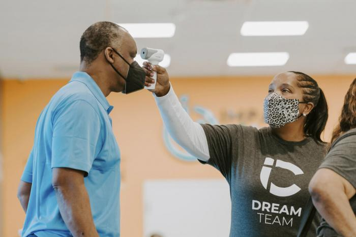 A man gets his temperature taken during a vaccination event held by Impact Church on Aug. 8, 2021, in Jacksonville, Fla.