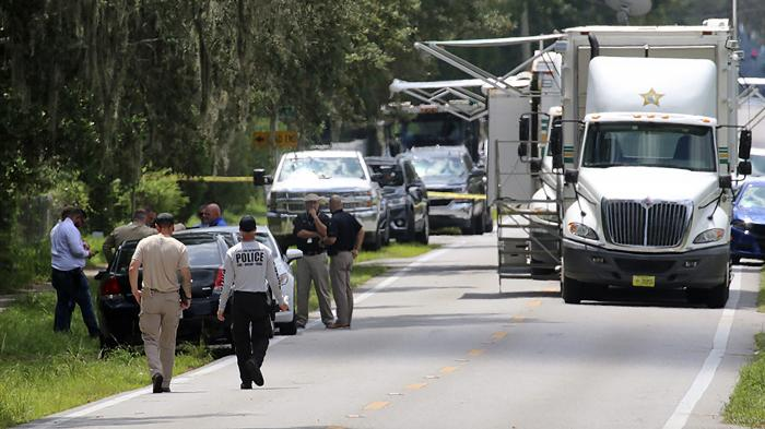 Polk County, Fla., Sheriff's officials work the scene of a multiple fatality shooting Sunday, Sept. 5, 2021, in Lakeland, Fla.